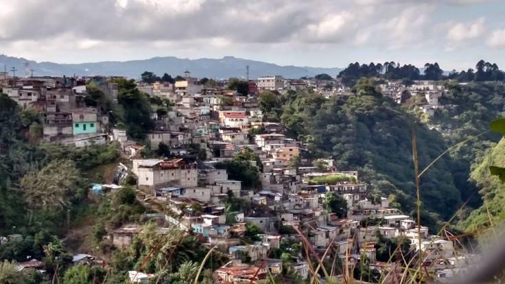 People who had to leave their rural communities came to the city in search of work. These are houses built on the ravines at the garbage dump where they often find themselves living when they can't find work here either.